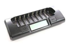 Новый цифровой заряжатель батареи на белизне Стоковые Фото