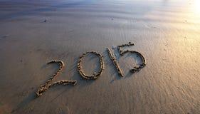2015 Новых Годов на песке пляжа Стоковое Изображение