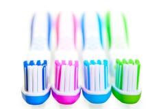 4 новых пестротканых зубной щетки Стоковая Фотография