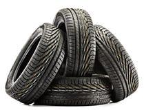 4 новых черных автошины изолированной на белизне Стоковые Фотографии RF