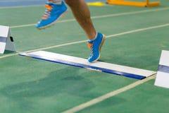 Нога посадки спортсмена на борту перед принимать  Стоковое Фото