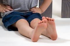 Нога ребенка младенца стоковые фото