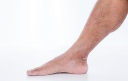 Нога человека на белой предпосылке Стоковая Фотография RF
