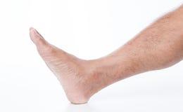 Нога человека на белой предпосылке Стоковые Изображения RF