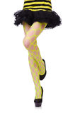 Ноги женщины в желтом fishnet Стоковые Изображения RF