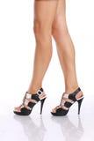 Ноги женщин с ботинками Стоковая Фотография