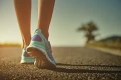 Ноги и ботинки бегуна Стоковые Фотографии RF