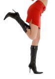 Ноги и задняя часть дамы в красной юбке Стоковое Фото