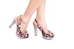 Ноги красоты в высоких пятках Стоковое Изображение