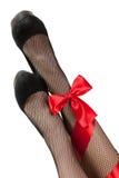 ноги пересеченные смычком девушок rad Стоковое Изображение