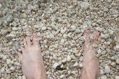 ноги прибоя Стоковое Фото