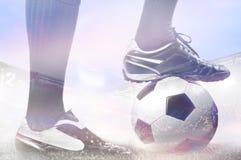 Ноги футбола или футболиста Стоковое фото RF