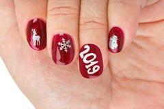 Ноготь пальца с картиной рождества стоковое изображение rf