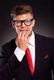 Ногти бизнесмена bitting Стоковое фото RF