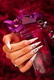 Ногти и бутылка элексира Стоковые Изображения