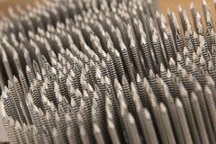 Ногти металла на пластичном крене для пневматических nailers дают полный газ Стоковое Изображение