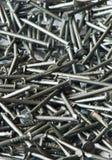 Ногти металла, предпосылка Стоковые Изображения