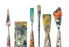 Ножи палитры и щетка на белой предпосылке стоковая фотография