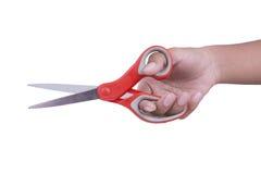 Ножницы владением руки на белой предпосылке Стоковое Изображение