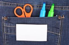 Ножницы и ручка в голубых джинсах pocket Стоковые Фотографии RF