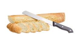 Нож багета и хлеба на светлой предпосылке Стоковое Изображение RF