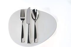 нож вилки над белизной ложки плиты Стоковое Фото