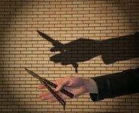 Нож в руке Стоковая Фотография