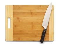 Нож и доска Стоковые Фото
