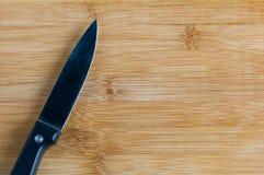 Нож на разделочной доске Стоковое Изображение RF