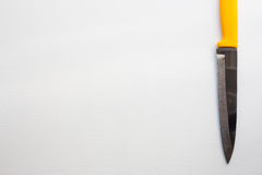 Нож с желтой ручкой Стоковые Изображения