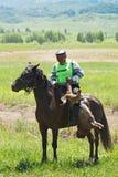 номад лошадей конкуренций kokpar традиционный Стоковое фото RF