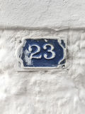 23 номера двери на стене здания Стоковые Изображения RF