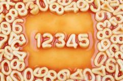 Номера в соусе макаронных изделия спагетти Стоковое Изображение RF
