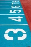 Номера голубого идущего следа Стоковая Фотография RF