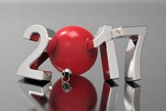 Номера Нового Года 2017 серебряные и красный шарик на черной предпосылке Стоковое фото RF