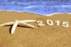 Номера 2015 Новых Годов на пляже моря Стоковое фото RF