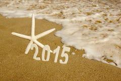 Номера 2015 Новых Годов на пляже моря Стоковая Фотография RF