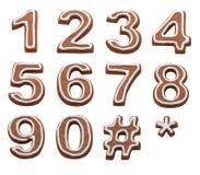 Номера пряника Xmas на белизне Стоковые Изображения