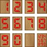 Номера цифров пластмассы на поверхности древесины Стоковая Фотография RF