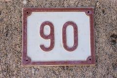 Номерной знак дома с концом-вверх 90 90 стоковая фотография rf
