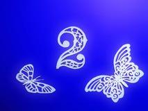 Номер два и бабочка отрезанные от белой бумаги стоковая фотография