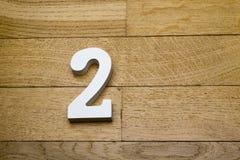 Номер два на деревянном, пол партера стоковая фотография rf