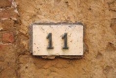 Номер дома на стене Стоковая Фотография