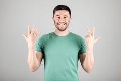 Номер показа человека пальцами Стоковая Фотография