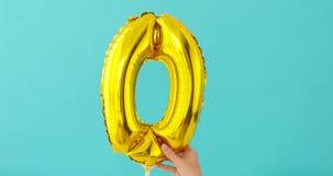 Номер o 0 сусального золота нул воздушных шаров торжества видеоматериал