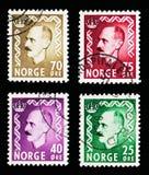 4 норвежских штемпеля почтового сбора показывают serie короля Haakon VII, около Стоковое Изображение