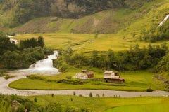 Нордическая деревня на реке Стоковые Изображения