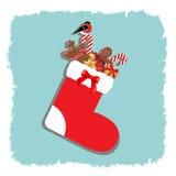 Носок рождества с подарками иллюстрация штока