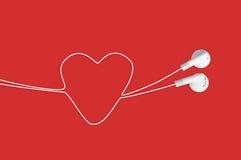 нот влюбленности сердца i наушников Стоковая Фотография