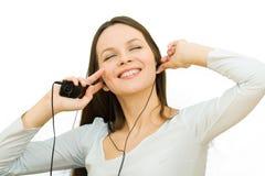 нот девушки слушая к детенышам Стоковое фото RF